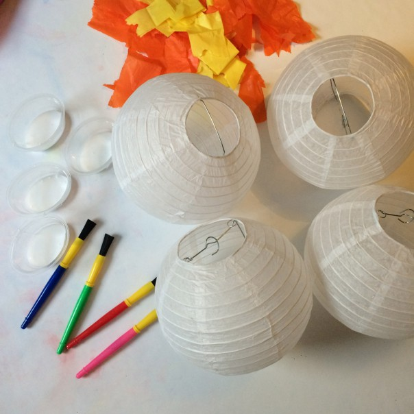 Small paper lanterns (approx. 8 inch diameter), coloured tissue paper, PVA glue and brushes.