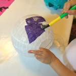 Cover the lantern in PVA glue and stick the tissue paper on.