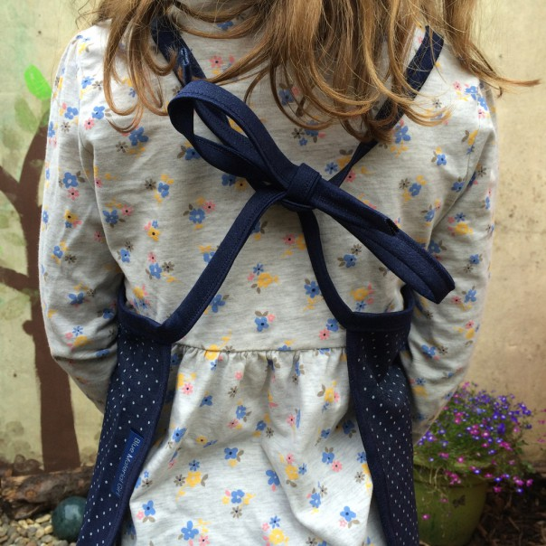 One size fits ages 3 - 7 years. You can tie the back to fit.