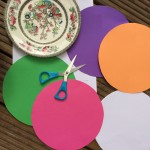 Use a plate as a template to cut circles of white and coloured paper or card.