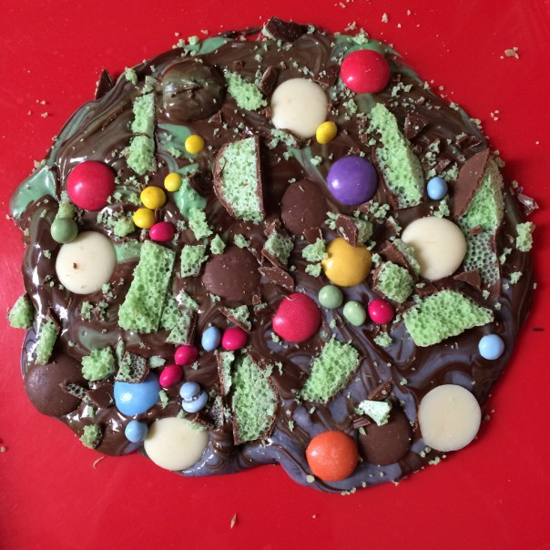 Cover the chocolate with sweets and chocolates. We used mint Aero, chocolate buttons and chocolate beans.