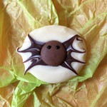 Spider chocolates. Use white chocolate for the base and dark chocolate for the body. Drag out 8 legs and use a chocolate button for the head.
