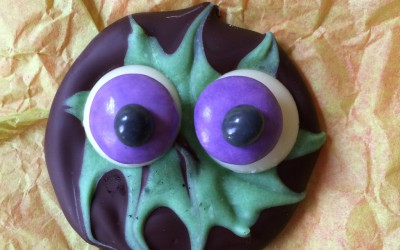 Once the chocolate is set, add white chocolate buttons and chocolate beans to make eyes. I used glace icing as glue.