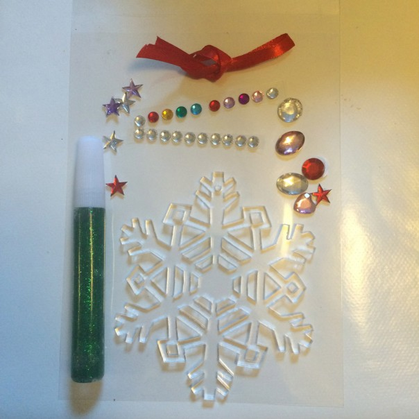 Snowflake decorating kits. Each kit has a wooden or acrylic snowflake, self adhesive jewels, ribbon and a glitter glue pen. Snowflake kit £5 each or 2 for £8