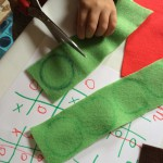 Draw noughts and crosses on the felt and cut out.