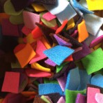 Cut different coloured felts into shapes and keep in a box.