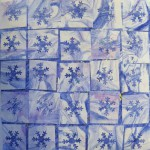 The boy called this a snowstorm card. Large square of decorated paper with lots of small punched out squares on top.