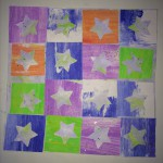 Stars. Punched out squares on top of decorated paper.