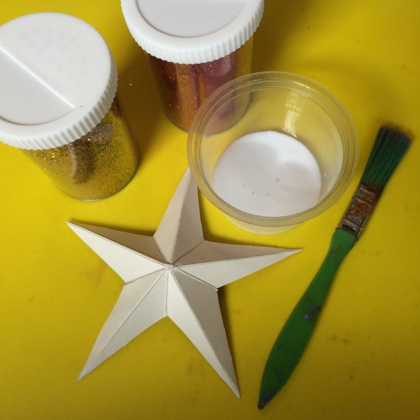 I wanted to make jewel encrusted stars so I used PVA glue, a paintbrush and glitter.