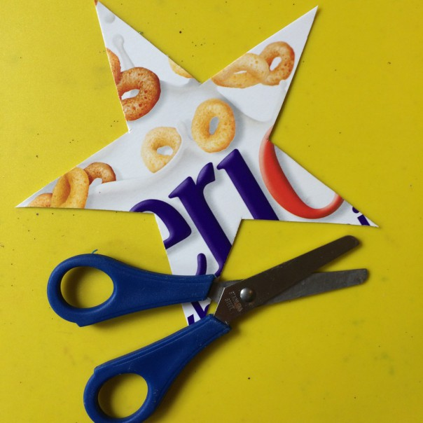 Cut around the template on the cereal box card to make a star.
