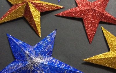 A selection of glitter covered and painted stars.