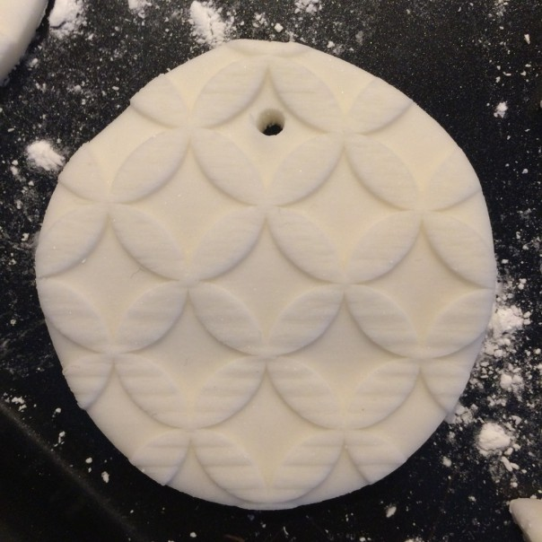 Embossed modelling clay cut into rounds.