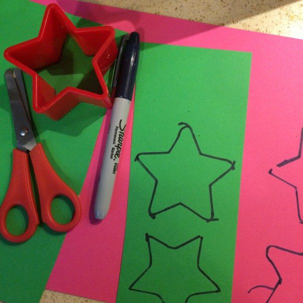To make puffy paint ornaments draw around a template (kids can do this).