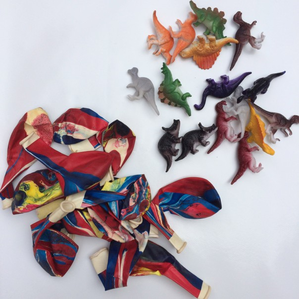 Miniature plastic dinosaurs and balloons (you need to choose balloons that are quite strong, the cheap ones split and tear easily).