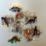 Little plastic dinosaurs (about 1 inch height).