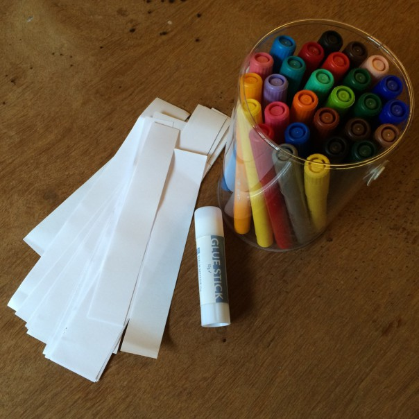 Paper strips, felt pens and glue stick.