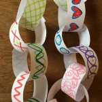 Draw patterns and pictures on the strips and glue together to make a chain.