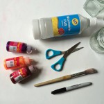 PVA glue, paintbrush, glitter glue, scissors and marker pen.