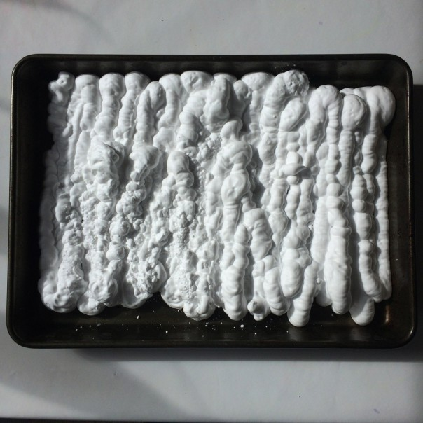 Spray a layer of shaving foam into a baking tray.