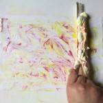 Using a ruler, scrape the excess shaving foam off the paper in one firm movement. Marbled paper!