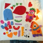 Before we started I cut out some bodies and features from different coloured felt. The boy and girl had lots of fun trying out different features on the Love Monsters.