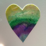 Close up of a salt resist watercolour heart.