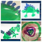 The boy's gallery. After painting one circle he got into painting dinosaurs. The salt made a lovely effect on the dino's skin.