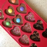 Decorate the bottom of the chocolate if you wish. Put in the fridge for an hour to harden. Pop the chocolates out of the mould and enjoy!