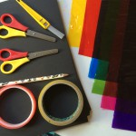 Black card, coloured acetate sheets, scissors, pencil, craft knife (adults only), sticky tape. You will also need a glue stick.