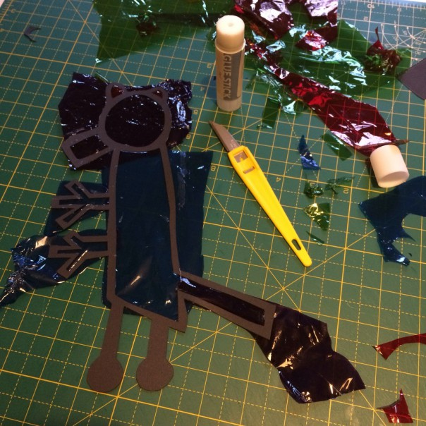 Once the boy had covered his allosaurus I trimmed the excess acetate with a craft knife.