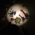 The boy and girl got out some musical instruments and played a soundtrack to their puppet show.