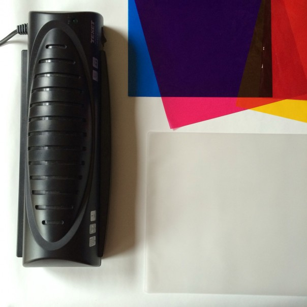 Laminator, laminator pouches and coloured cellophane sheets.