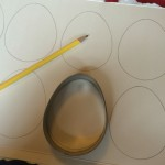 Draw egg shapes onto the card and cut out.