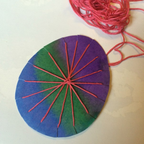 Try winding the thread round the egg shape in different ways to see what effects are created.