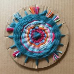 Continue weaving until the circle is full. Keep the weaving on the cardboard  base to display.
