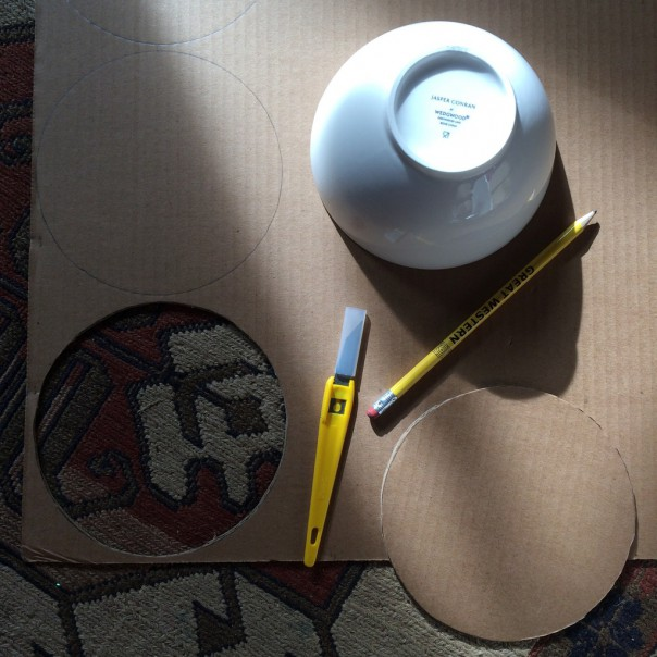Cut a circle out of cardboard using a bowl as a template.