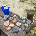 Our collection of decorated beach stones.