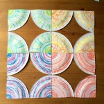 Cut each paper plate into quarters.