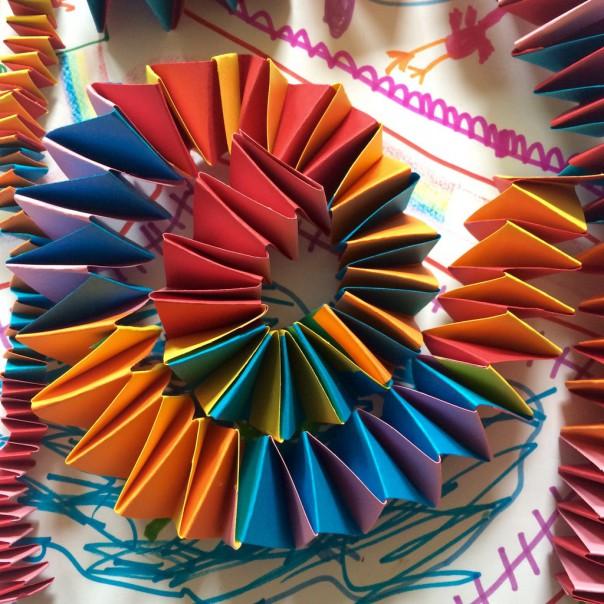 Multi coloured accordion paper chain spiral.