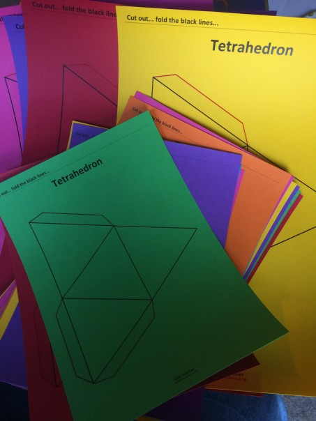 Tetrahedron nets printed on coloured card stock.
