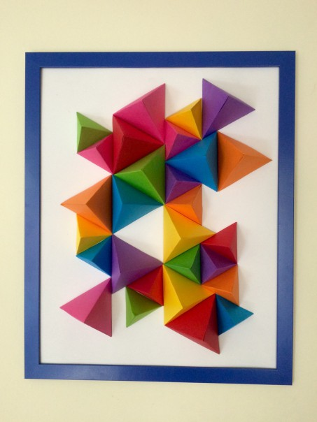 We stuck our tetrahedrons to a piece of card and put them in a frame, with the glass taken out, and hung it on the wall.