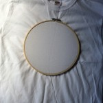 White t-shirt and embroidery hoop.