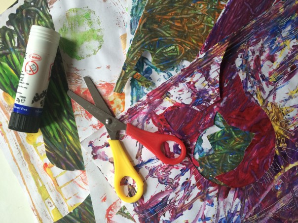 Marble painting papers, scissors and glue stick.