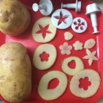 Potatoes, knife, cookie cutters and sugar paste cutters.