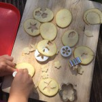 Cut out shapes from potato slices.
