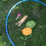 Hula hoop, chopsticks, wool and scissors.