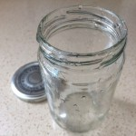 Clean jam jar with lid.