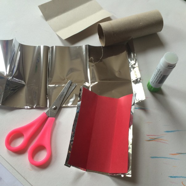 Mylar, card stock, cardboard tube, glue and scissors.