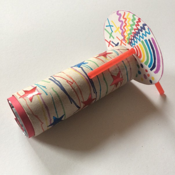 Decorate the circle with colourful patterns. Attach the circle with a trimmed bendy straw and tape.