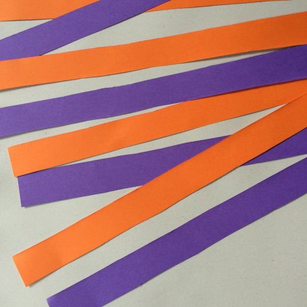 Coloured card strips, approx. 5cm wide.